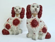 Pair Holkham pottery Staffordshire-type model spaniels with russet colouring, 32cm high (2)