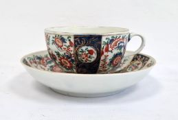 Worcester teacup and saucer, 1760-1770, blue fret marks and iron-red chinoiserie-style monogram,