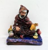 Royal Doulton pottery seated figure 'The Potter' HN1493, 17cm wide