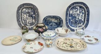 Two large 19th century meat plates, a smaller 19th century blue and white Rockingham pottery dish, a