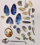 White metal spoonin the form of a golf club and a collection of iridescent mother-of-pearl pendants