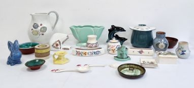Poole pottery tableware, Poole pottery model dolphins, posy vases, a Sylvac blue pottery rabbit,