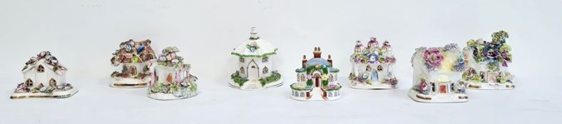 Collection of eight various bone china porcelain and pottery incense burners in the form of cottages