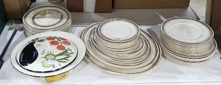 Solionware part dinner serviceincluding meat platters, dinner plates, side plates, etc and a
