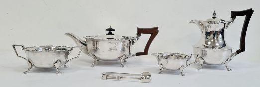 Four-piece silver tea servicecomprising teapot, hot water jug, two-handled sugar bowl, milk jug and