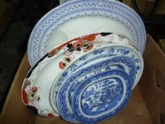 Six various large meat platesincluding Wedgwood 'Willow' pattern and one smaller (7)