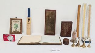 19th century brass cribbage board, an autograph book, a miniature cricket bat, various rulers, a