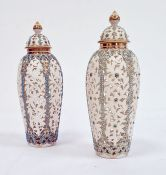 Pair of Worcester 'Grainger & Co' reticulated slender oviform Persian-style vases and domed