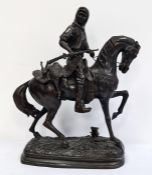 In the Manner of Alfred Barye; Bronze figure of a hunter carrying dead game, on horseback