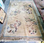 Chinese yellow ground rug with floral spray decoration, 154 x 245cm