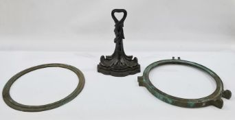 A bronze porthole and a 19th century Coalbrookdale style doorstop