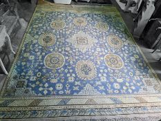 Large Chinese blue ground rug, the central medallion surrounded by further medallions, the sky