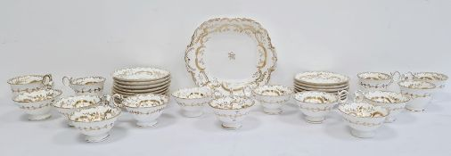 English porcelain part tea service, mid 19th century, pattern no. 4/987, gilt with fronds and