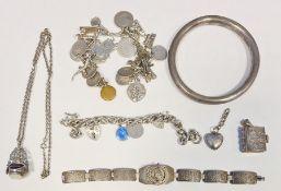 Hollow silver bangle, a silver charm bracelet, various charms, etc