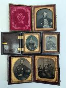 Family portrait photographic miniatures, some set in brown leather cases