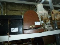 Small black metal trunkwith key, a sewing machine, a brass table lampand a metal and glass twin