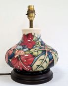 Moorcroft pottery table lamp, squat baluster shape and having tube-lined hibiscus decoration,