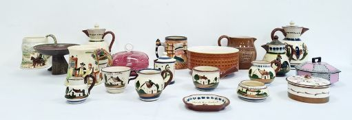 Collection of Torquay pottery ware to include hot water jugs, milk jug, cups, etc, a 20th century