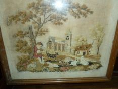 Late 19th century petitpoint needlework pictureshowing a boy sitting with a dog, dogs in the