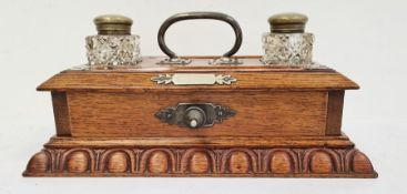Late 19th century oak desktop inkwellwith a pair of cut glass ink bottles with brass mounts and