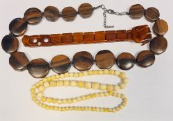 19th century ivory-effect graduated beads, a rosewood carved beaded necklaceand an amber-effect