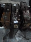 Two vintage leather suitcases, one with various travel labels, another suitcase and two boxes of