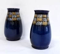 Pair of blue glazed Royal Doulton vases with stylised border (2)