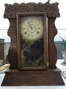 Late 19th/early 20th century American mantel clock in carved Art Deco style oak case, the movement