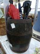 Half-barrel, two umbrellas, a back scratcher, a picnic seat, a picnic basket, a brass table lamp