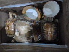 Various items of cottagewareto include teapot, butter dish, cream jug, lidded pot, teacup and