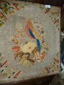 Embroidered beadwork showing a cockerel with crystal beads, the bird embroidered with a glass eye,
