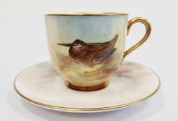 Royal Worcester matched demi-tasse and a saucer, the cup with printed black marks, painted by J.