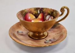Royal Worcester fruit painted teacup and saucerby E. Townsend, printed puce and blue marks, 20th