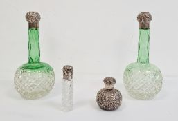 Pair of Victorian green cut glass hobnail perfume bottleswith silver embossed tops,a small example