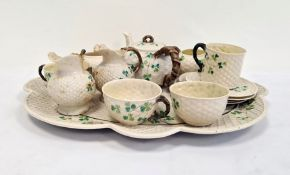 Belleek porcelain cabinet set comprising lobed oval tray, teapot with branch-pattern bifocated