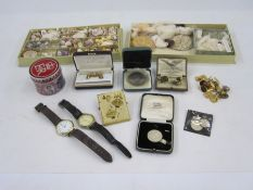 Two boxes of shellsincluding very small shells,cufflinks,a Power Diesel paperclipandother items
