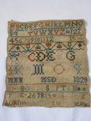 Samplerdated 1815 including alphabet, numerals, 26cm x 23cm, unframed
