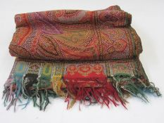 Early 20th century woven paisley shawl, allover colours green, red, turquoise, etc, the border in