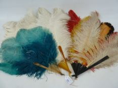 A turquoise and bakelite ostrich feather fan, a white ostrich feather fan and another multi coloured
