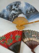 A quantity of souvenir fans, mostly Oriental