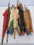 Various vintage parasols, in varying conditions, including one trimmed with ostrich feathers and