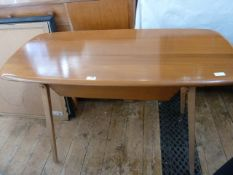 Ercol elm serving table, rounded rectangular with under sliding drawer, on square section