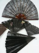A tortoiseshell (?) and black lace fan, a wooden and black lace fan, a black wooden fan with painted
