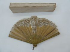 An early 20th century wooden and painted gauze fan,gold decoration depicting an owl painted in