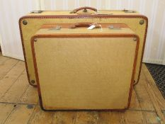 Leather canvas and leather suitcasewith a smaller matching made by Victor Luggage, the smaller case