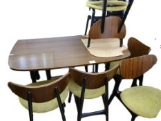 A G-plan Librenza teak dining table on ebonised legs, a set of six G-plan butterfly teak and