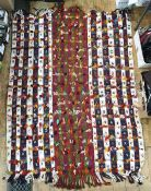 Large multi-coloured cotton kelim-style rug with hand knotted loose threads and fringes at two ends,