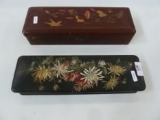 Two Oriental lacquered glove boxes, one red lacquer with hinge lid and one black lacquer with red