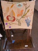 A small folding beach/ picnic vintage chair, with an embroidered linen back