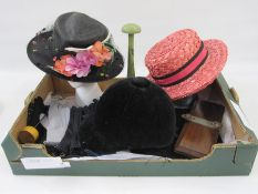 Vintage black straw hatwith net detail, faux-flowers and a leaf, a pink straw boaterlabelled 'Miss